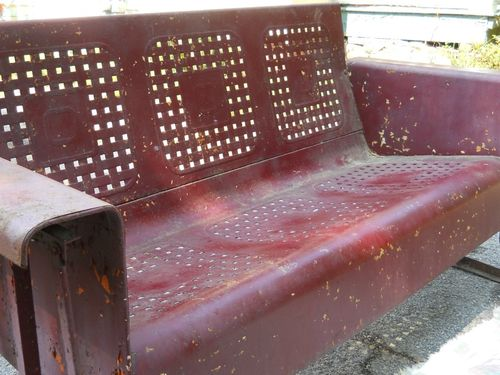 old rusty metal porch glider