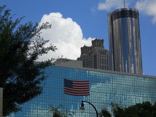 Downtown Atlanta blue sky American flag